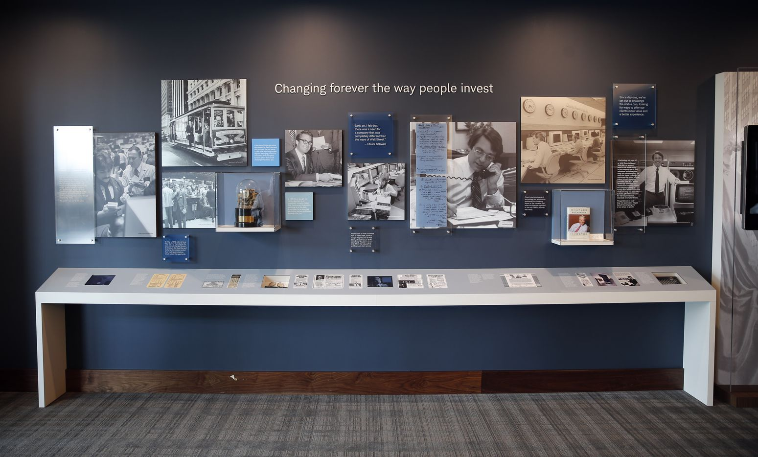 A wall showcasing the history of Charles Schwab in the company's new campus in Westlake. (Vernon Bryant/The Dallas Morning News)