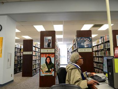 Library member Veronica Miller researches on a computer at the Mesquite Main Library.