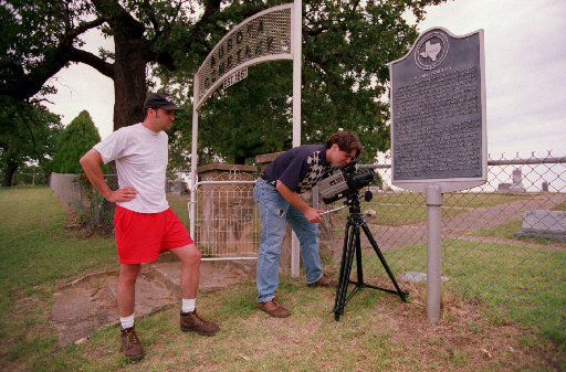 FILE: University of North Texas graduate student Peter Coates (left) and Senior Joe Schwartzott video tape  a historical marker at Aurora Cemetery in 1995, where  an alien is allegedly buried after crashing his space craft near  the town in 1897.