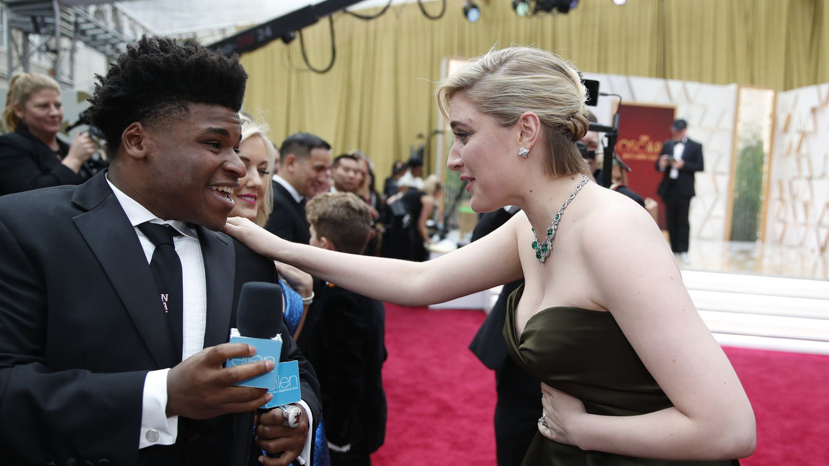 Greta Gerwig, right, talks to Jerry Harris on the red carpet at the Oscars on Sunday, Feb. 9, 2020, at the Dolby Theatre in Los Angeles.