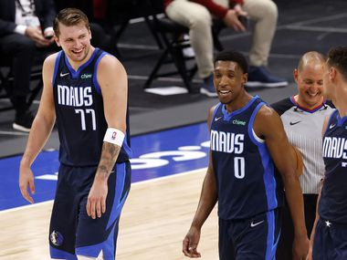 Dallas Mavericks guard Luka Doncic (77) and his teammates are all smiles as they leave the floor with a halftime lead over the Cleveland Cavaliers at the American Airlines Center in Dallas, Friday, May 7, 2021.