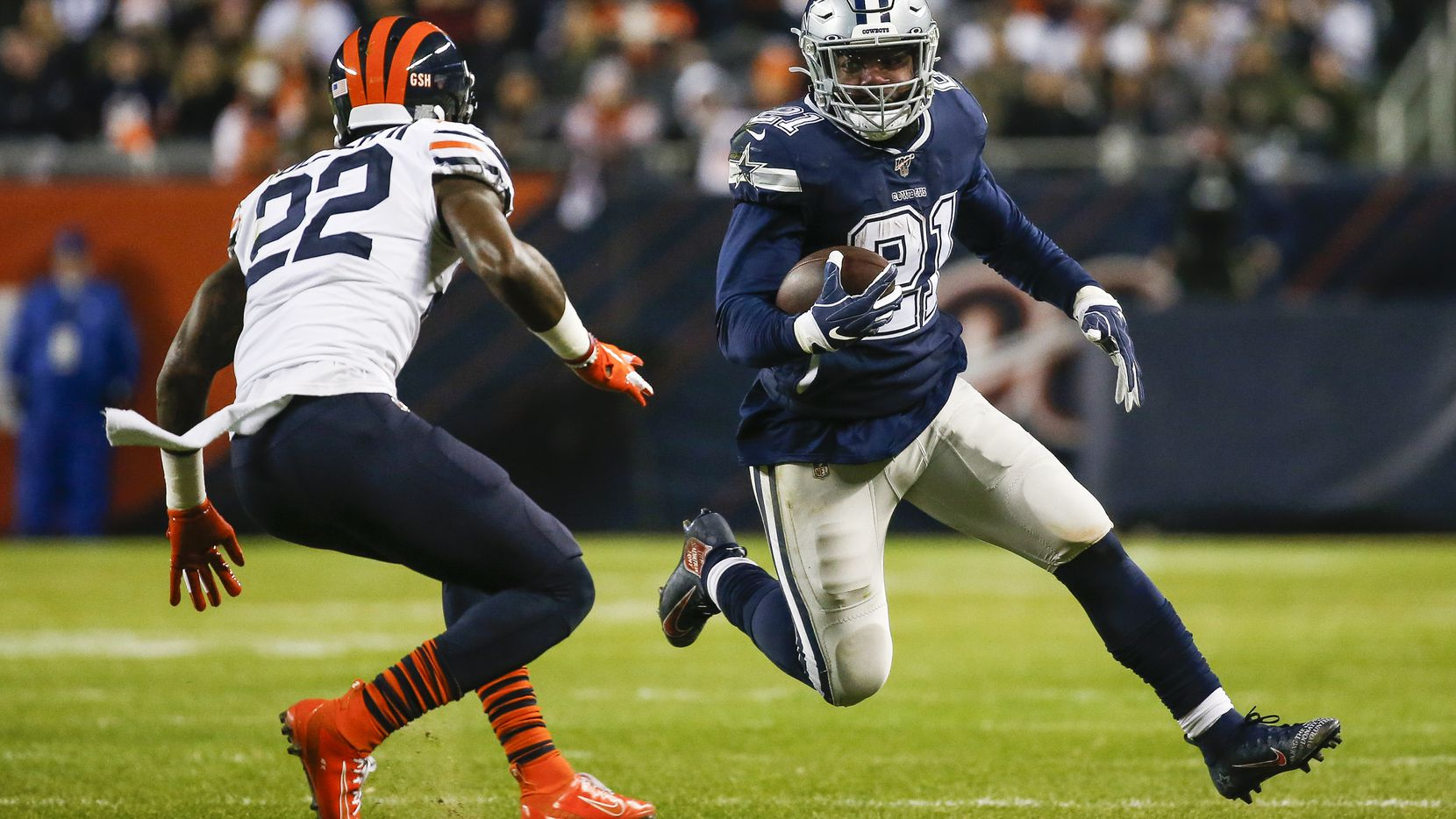 Dallas Cowboys running back Ezekiel Elliott (21) makes a break past Chicago Bears defensive back Kevin Toliver (22) during the first half a NFL matchup between the Dallas Cowboys and the Chicago Bears on Thursday, Dec. 5, 2019, at Soldier Field in Chicago. (Ryan Michalesko/The Dallas Morning News)