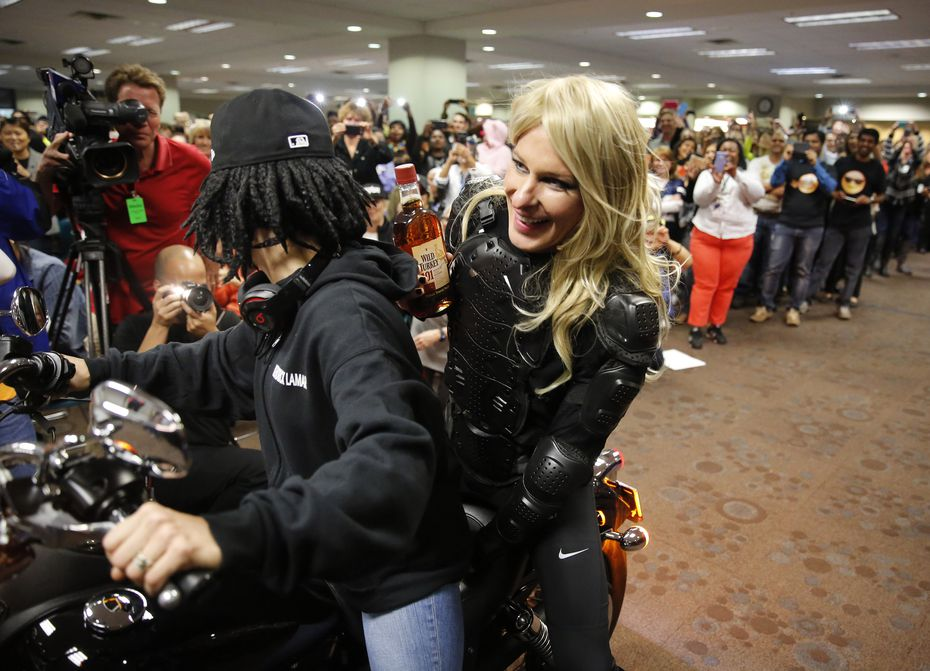 To best former Southwest Airlines CEO Herb Kelleher, American Airlines executive vice president of people and communications Elise Eberwein (dressed as Kendrick Lamar, driving) and president Scott Kirby (dressed as Taylor Swift) met the challenge and rode a Harley Davidson through the American Airlines Headquarters in Fort Worth in 2015.