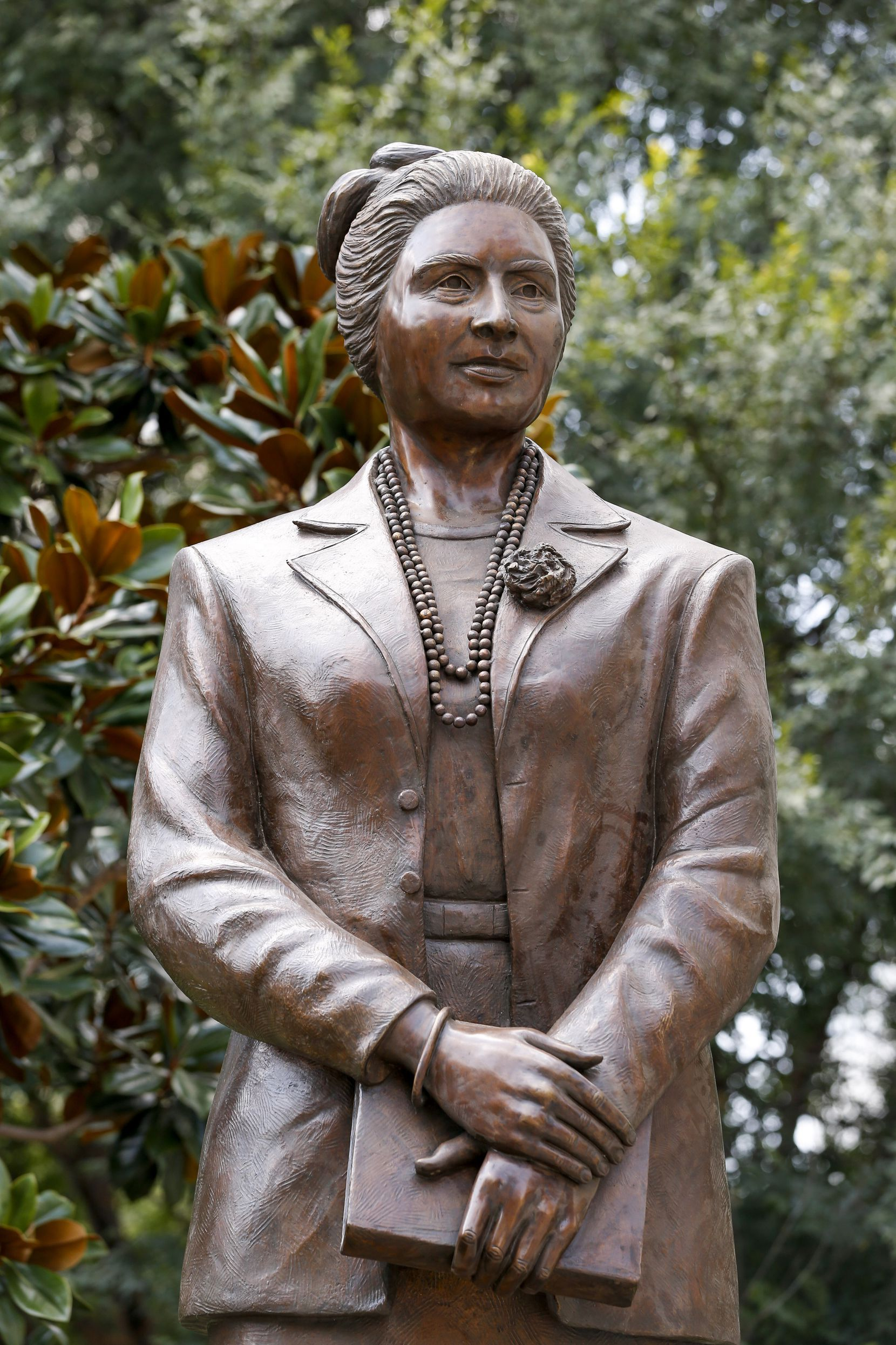 A bronze statue of Mexican-American civil rights leader Adelfa Callejo stands in Main Street Garden Park on Thursday, Aug. 26, 2021, in Dallas.
