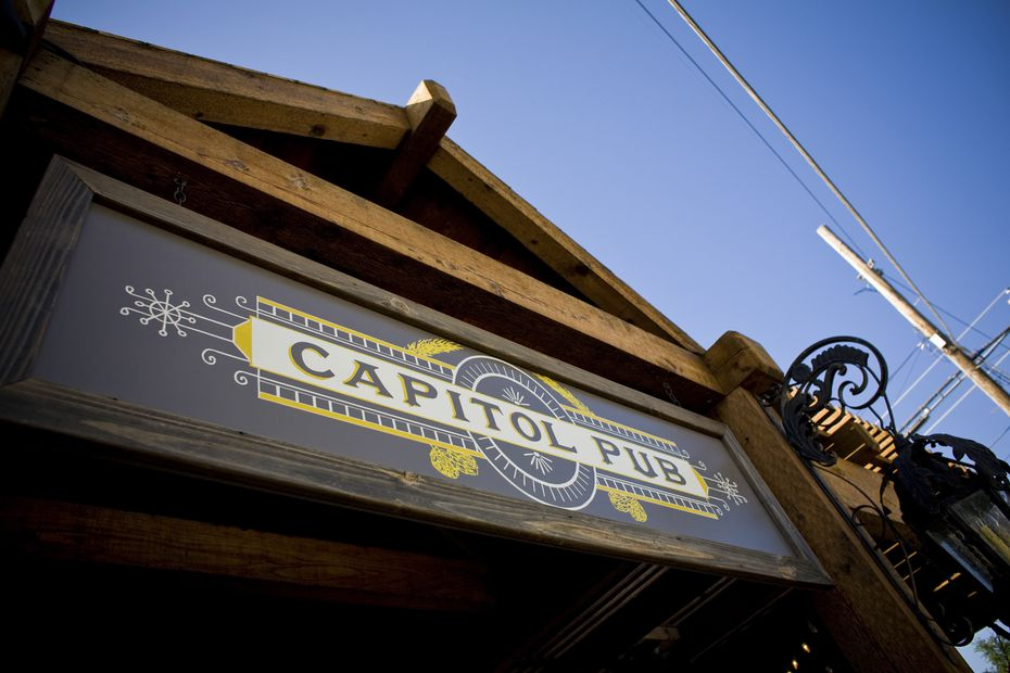 """Capitol Pub has been a watering hole popular on Henderson Avenue for more than a decade. We wrote in 2007, """"Capitol Pub's aesthetic is almost Uptown-ish. It has a large patio with a fireplace; a clean, dark-wood interior and a long beer list. """""""