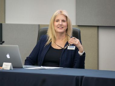 McKinney ISD board of trustees, led by president Amy Dankel, approved a property tax rate decrease at Tuesday night's school board meeting.
