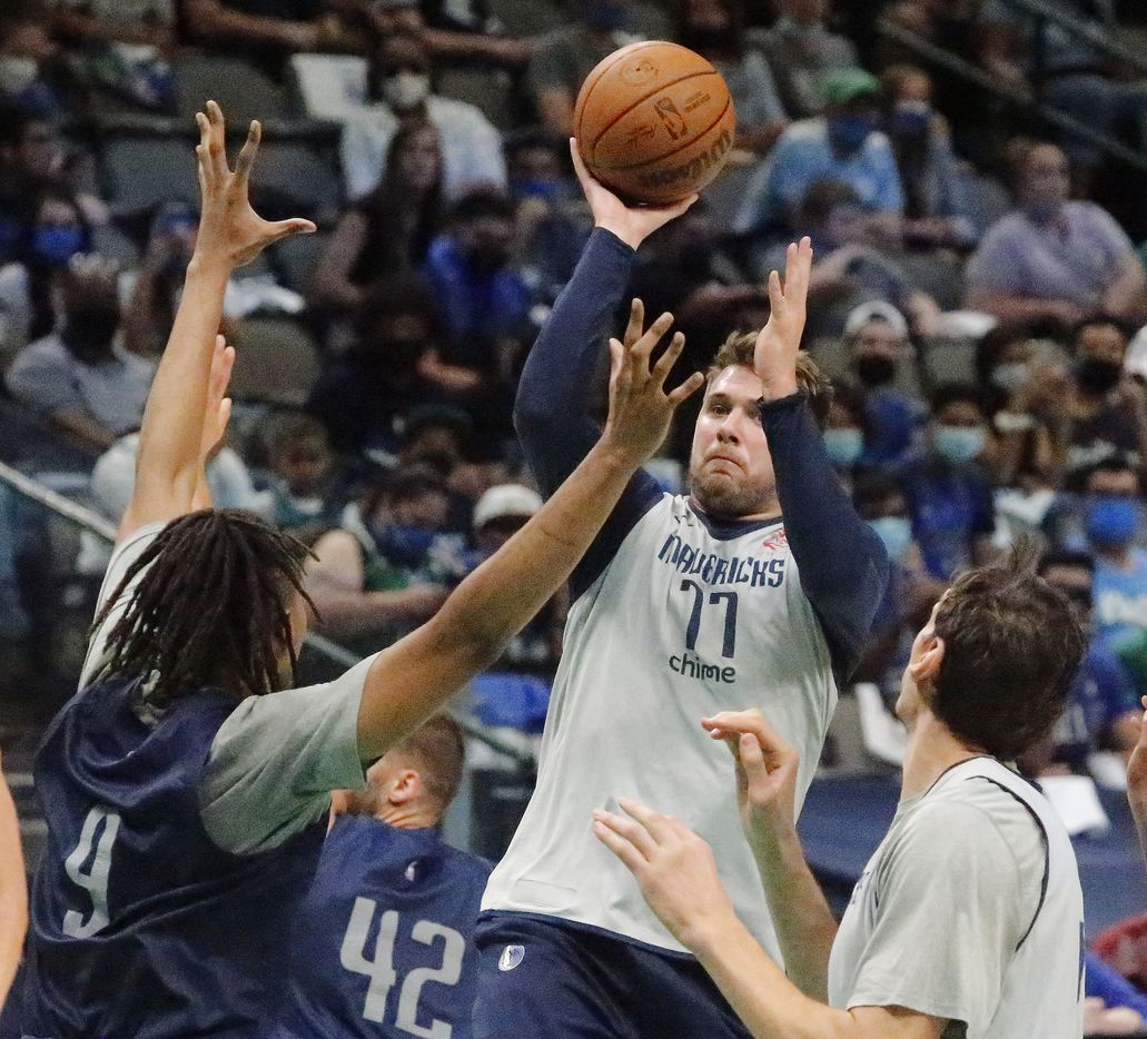 Dallas Mavericks guard Luka Doncic (77) shoots a running shot on Dallas Mavericks center Moses Brown (9) as the Dallas Mavericks held their Mavs Fam Jam, a scrimmage free to the public at the American Airlines Center in Dallas on Sunday, October 3, 2021. (Stewart F. House/Special Contributor)