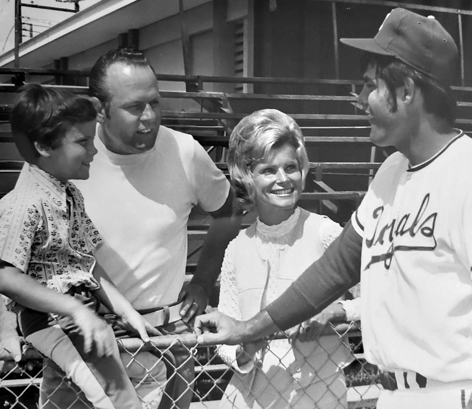 Bob Stiegler, his wife, Norma, and their son Greg chat with Lou Piniella of the Kansas City Royals in Florida during spring training in 1972. Bob was a salesman for the Royals.
