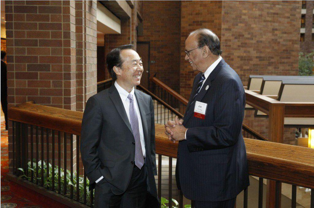 Shin Takahashi talking to Ashok Kumar Mago at the Dallas Regional Chamber annual meeting in January, 2015.