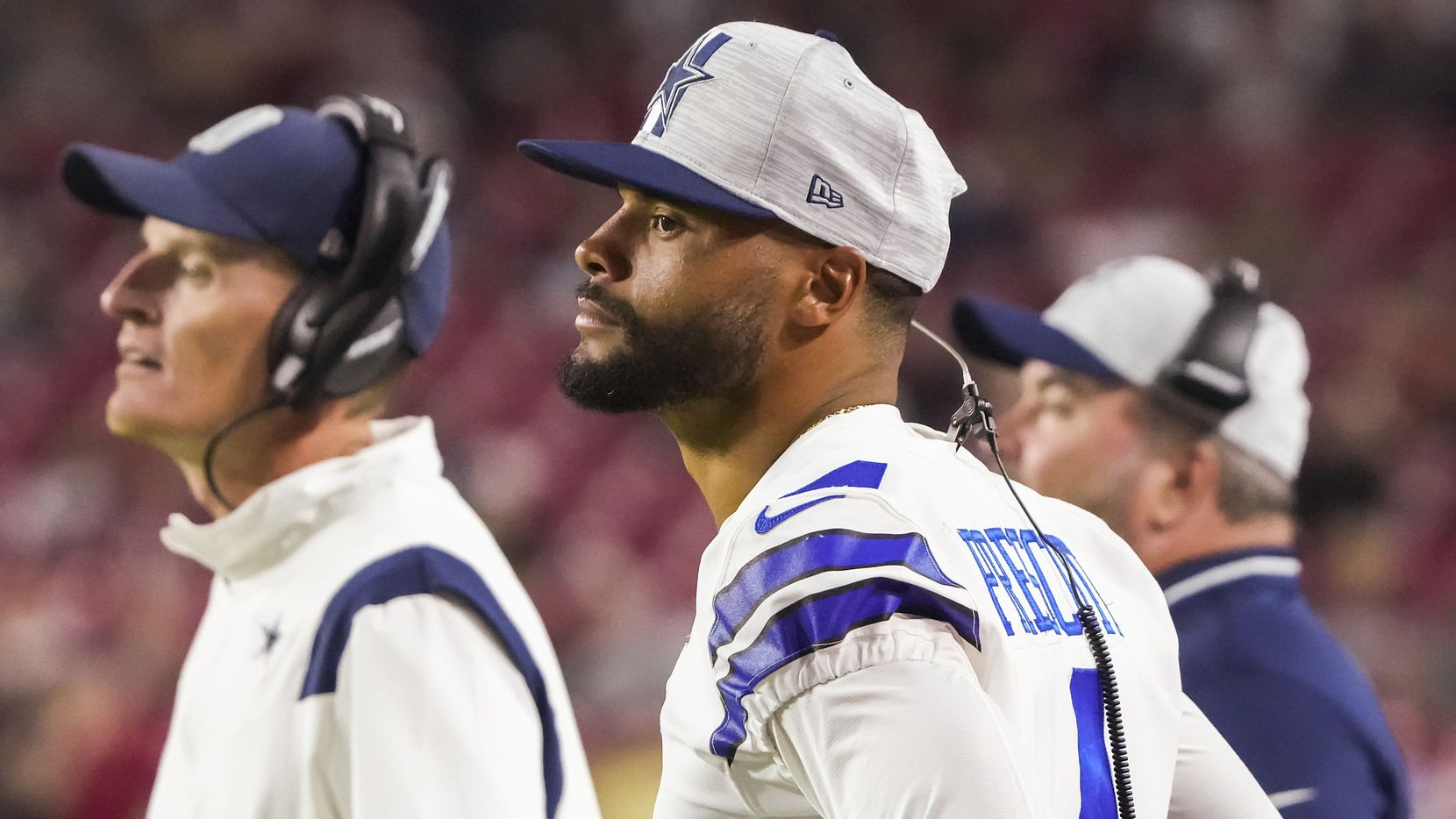 Dallas Cowboys quarterback Dak Prescott watches from the sidelines during the first quarter of an NFL football game against the Arizona Cardinals at State Farm Stadium on Friday, Aug. 13, 2021, in Glendale, Ariz.