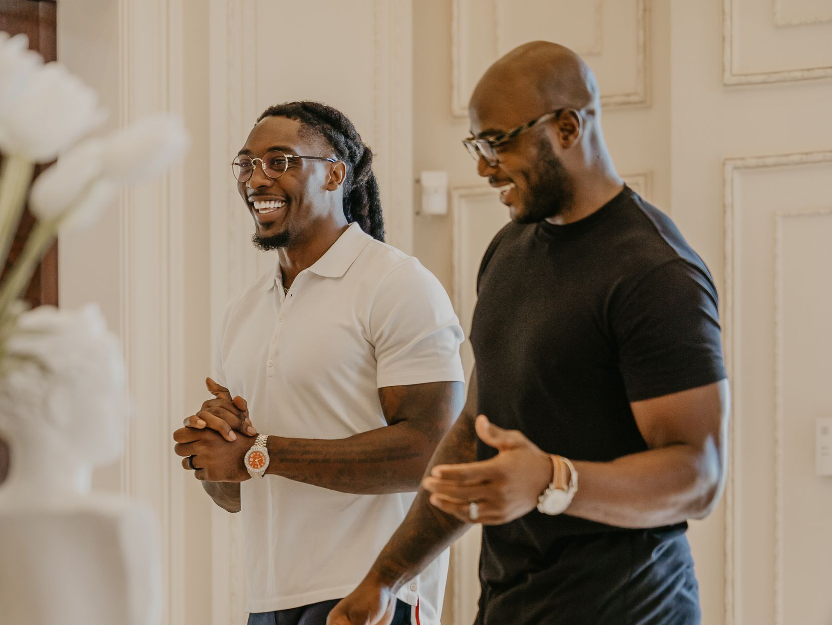 """DeMarcus Lawrence (left) and DeMarcus Ware enjoy a laugh while shooting an episode for Avondale's new original series """"Intersections."""""""
