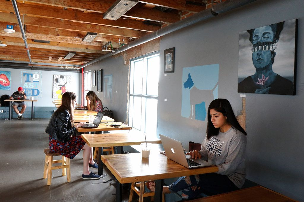 Shelby Novakovich, left, and Elizabeth Vazquez, right, relax at Toasted Coffee + Kitchen in Dallas on Tuesday, September 26, 2017. (David Woo/The Dallas Morning News)