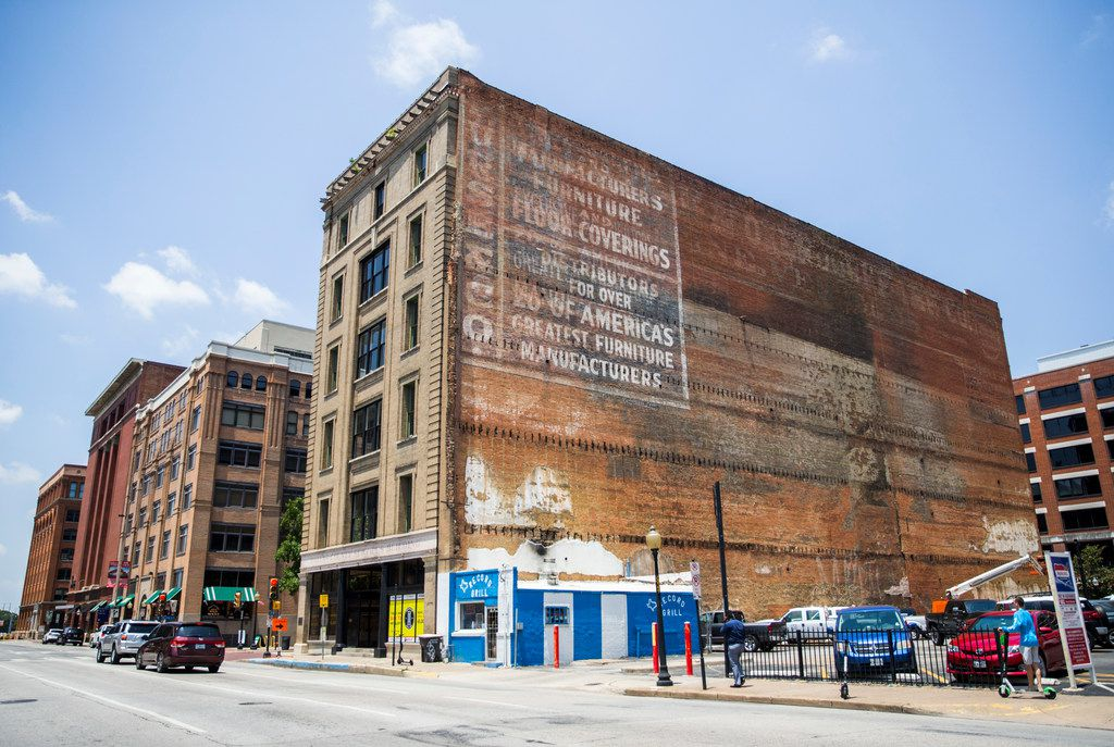 The outside of the historic Purse Building on Wednesday, July 10, 2019 in downtown Dallas. The old sign on the building's side dates back to its time it housed Purse & Co. Wholesale Furniture.