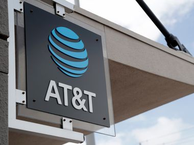 A sign is displayed at an AT&T retail store in Miami in this July 18, 2019 file photo.