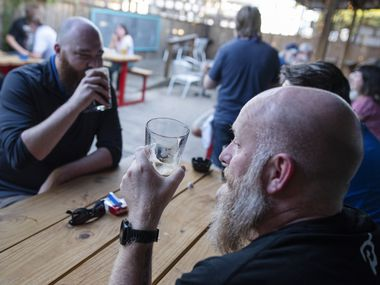 Justin Shelley (right) and Joe Melot enjoyed a beer on the patio at Dan's Silverleaf bar in Denton Wednesday evening.