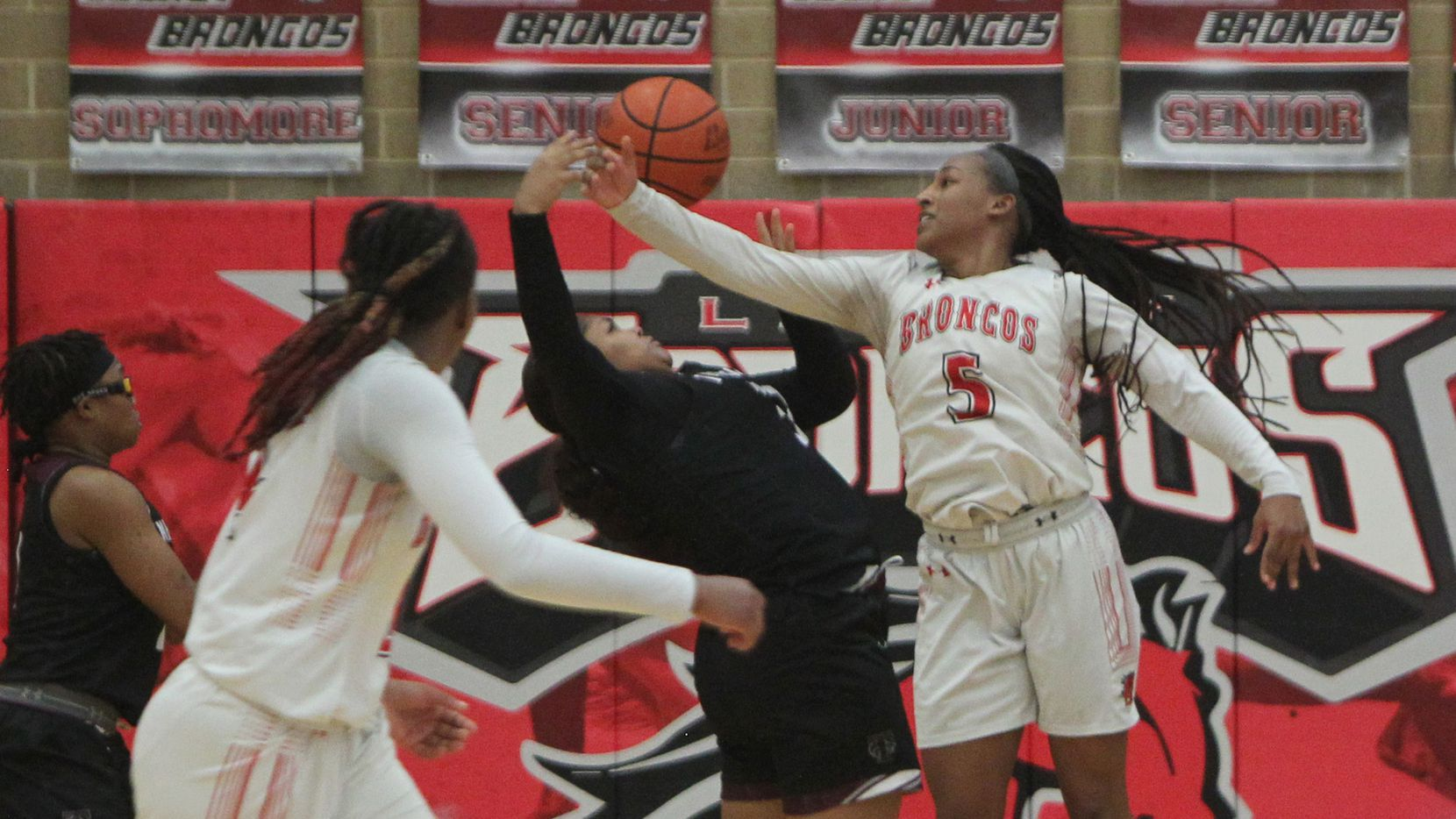 Mansfield Legacy guard Savannah Catalon (5) battles Mansfield Timberview post Trinity King (32) for a rebound during second half action. The two teams played their District 8-5A girls basketball game at Mansfield Legacy High school on January 22 , 2021.
