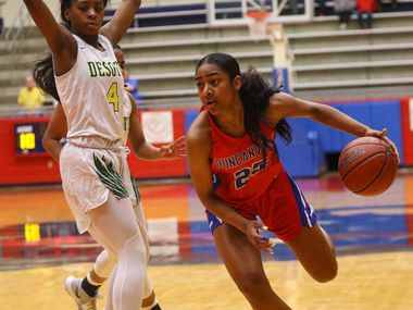 McDonald's All-American Deja Kelly (right) of Duncanville drives the ball during a 66-47 victory over DeSoto in the championship game of the Sandra Meadows Classic on Dec. 28. DeSoto and Duncanville will meet for the third time this season in a Class 6A Region I final on Tuesday at the Wilkerson-Greines Activity Center in Fort Worth.