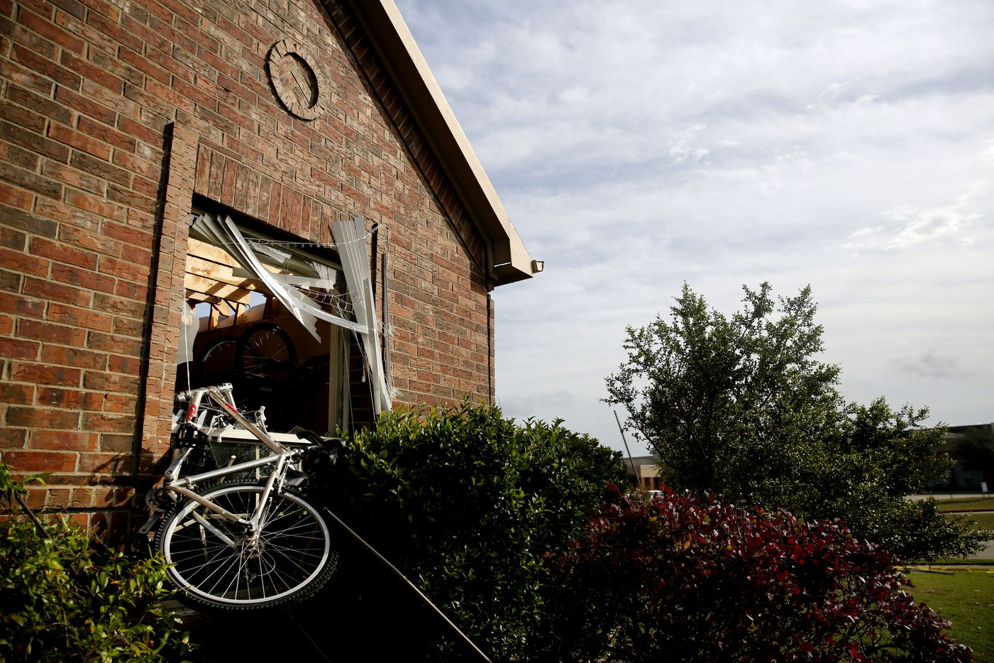 A bicycle was blown through the garage window of Michael Hampton's home along Tumbleweed Circle following a storm in the early hours of the morning in Rockwall, Texas on Wednesday, March 29, 2017. (Rose Baca/The Dallas Morning News)