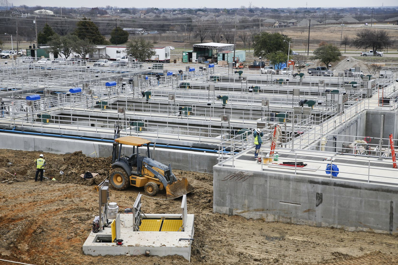 Construction crews work on upgrades to the Plant 1 settling basins at the North Texas Municipal Water District complex in Wylie. Annual payments by the 13 member cities help fund infrastructure and future projects.