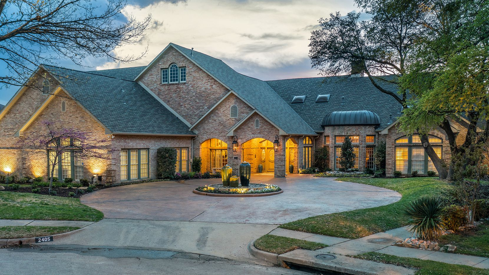 Listed for $2,225,000, the estate at 2405 Colonial Drive in Plano features a flexible floor plan, an apartment and golf course and creek views.