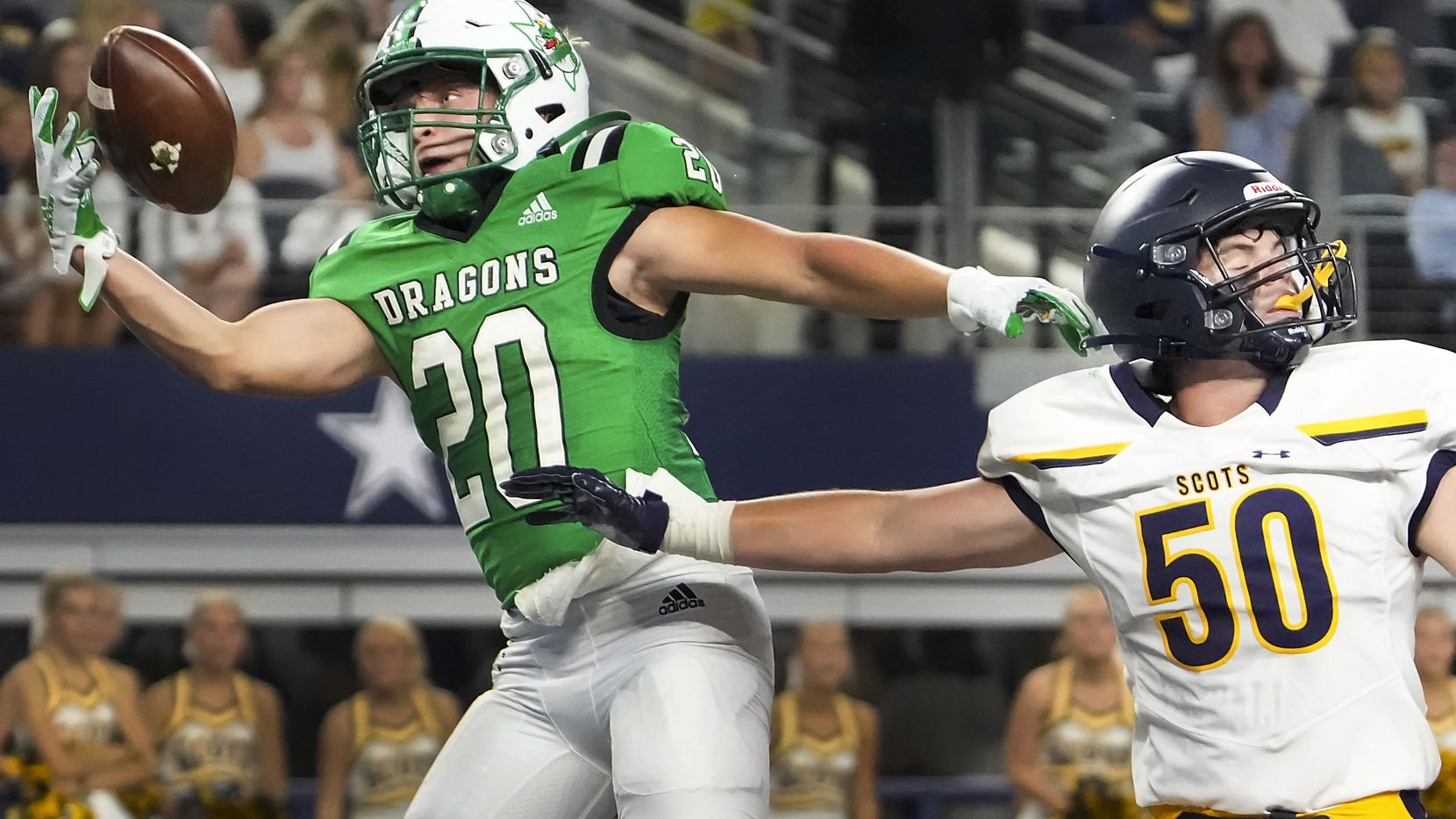 Southlake Carroll running back James Lehman (20) makes a one-handed catch for a touchdown as Highland Park's Thomas Oliver (50) defends during the first half of a high school football game at AT&T Stadium on Thursday, Aug. 26, 2021, in Arlington.