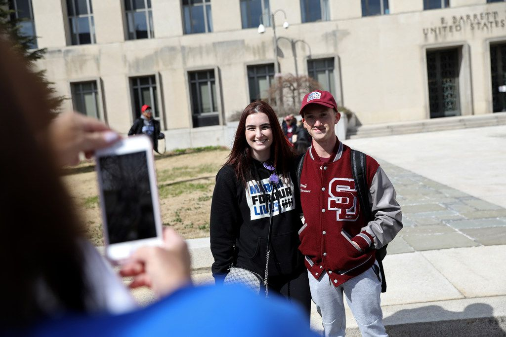 Katie Silverman found her Parkland friend Ryan Dewerff just as the march ended. Ryan is an 18 year old senior at Marjory Stoneman Douglas High School. (Bess Adler/Special Contributor)