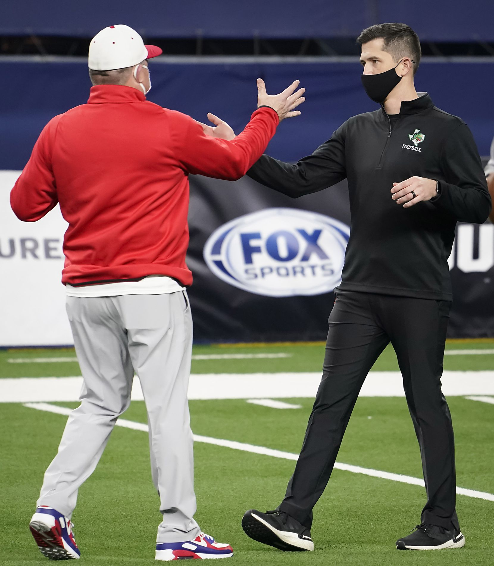 Southlake Carroll head coach Riley Dodge (right) shakes hands with his father, Austin Westlake head coach Todd Dodge, before the two faced in the Class 6A Division I state football championship game at AT&T Stadium on Saturday, Jan. 16, 2021, in Arlington, Texas.