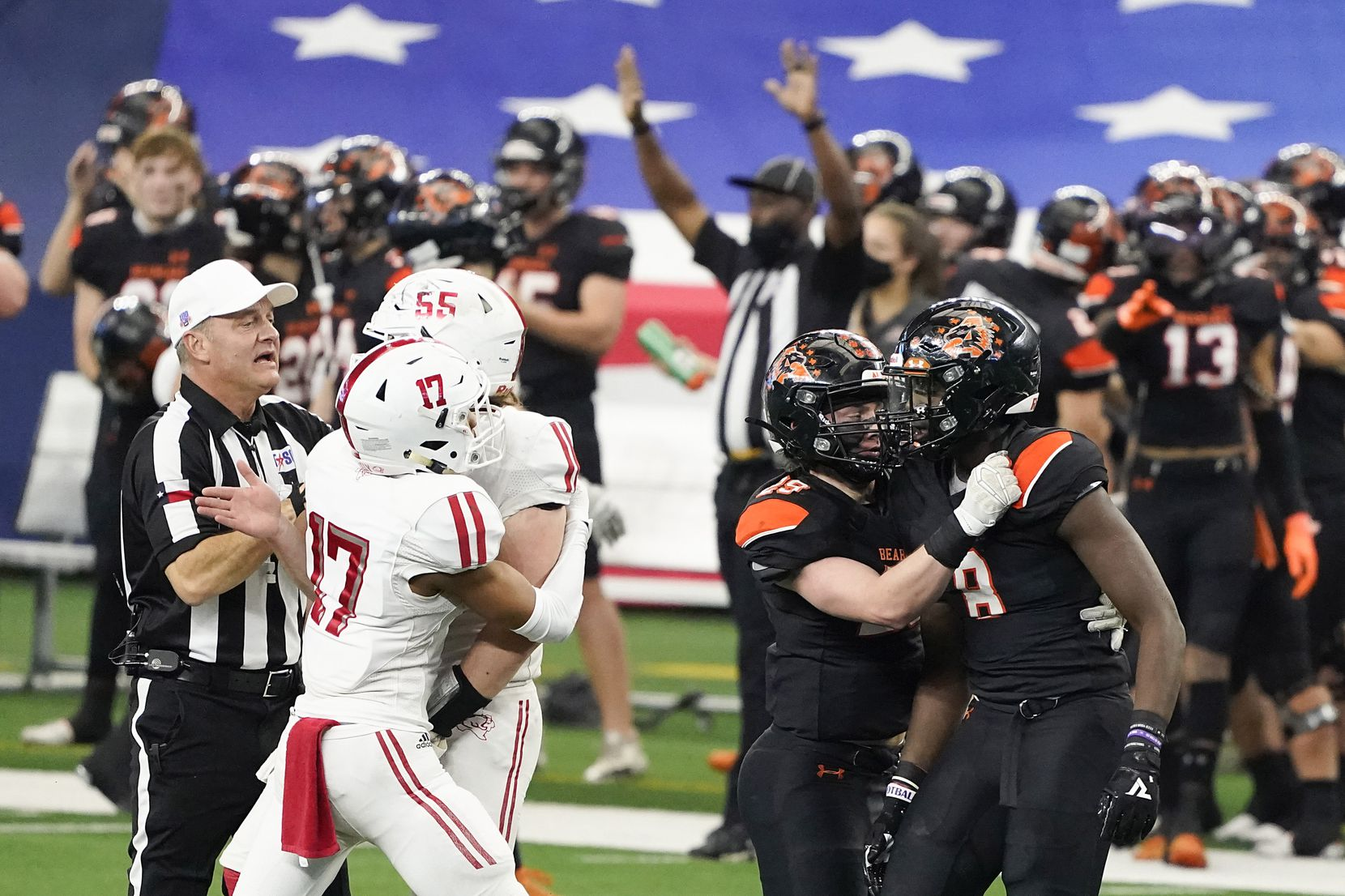 Teammates and officials race to separate Crosby offensive lineman Tyler Thomas (55) from Aledo defensive lineman Chris Wright (8), who were both penalized on the play, during the first half of the Class 5A Division II state football championship game at AT&T Stadium on Friday, Jan. 15, 2021, in Arlington. (Smiley N. Pool/The Dallas Morning News)