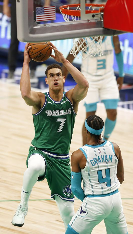Dallas Mavericks center Dwight Powell (7) makes his way to the basket as he is defended by Charlotte Hornets guard Devonte' Graham (4) during the first quarter of play in the home opener at American Airlines Center on Wednesday, December 30, 2020 in Dallas. (Vernon Bryant/The Dallas Morning News)