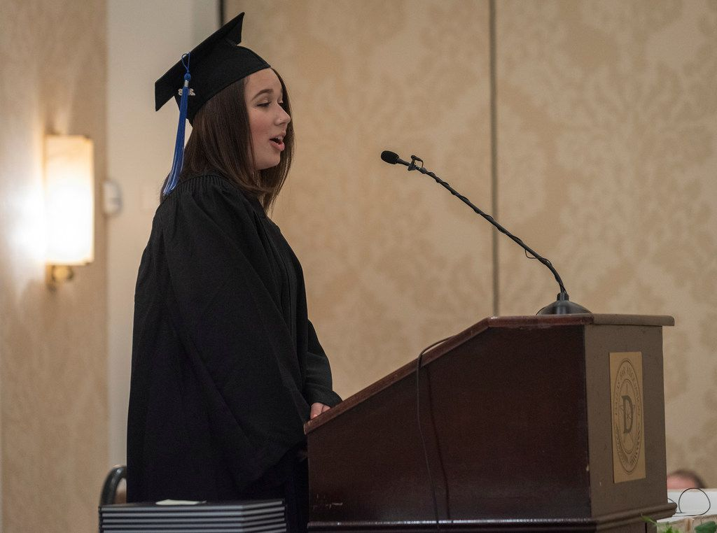 Aliya Swanger, student council president of the Alcuin School, talks about the traditions set by the schools first graduating class during commencement services at the Belo Mansion on Thursday, May 24, 2018.