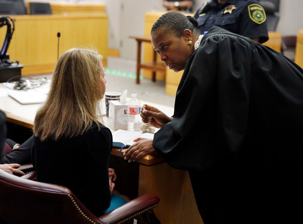 Judge Tammy Kemp opened a Bible to John 3:16 and gave it to Amber Guyger. She also gave her some words of encouragement to do something with her life following the 10-year sentence.