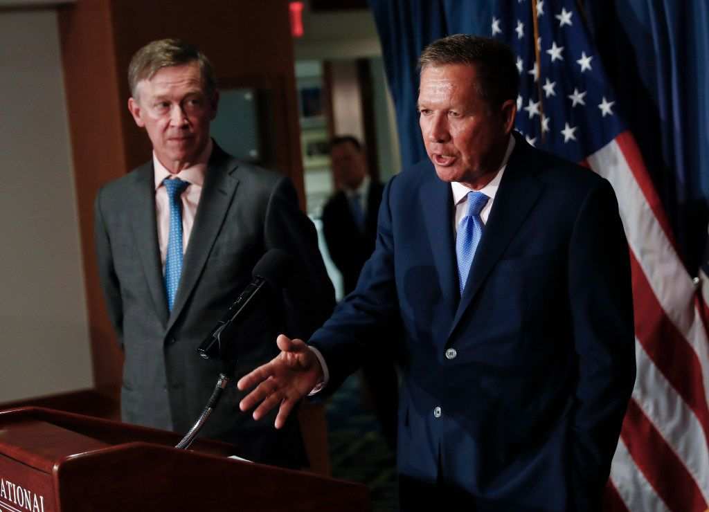 Ohio Gov. John Kasich, right, joined by Colorado Gov. John Hickenlooper, speaks during a news conference at the National Press Club in Washington, Tuesday, June 27, 2017, about Republican legislation overhauling the Obama health care law. (AP Photo/Carolyn Kaster)
