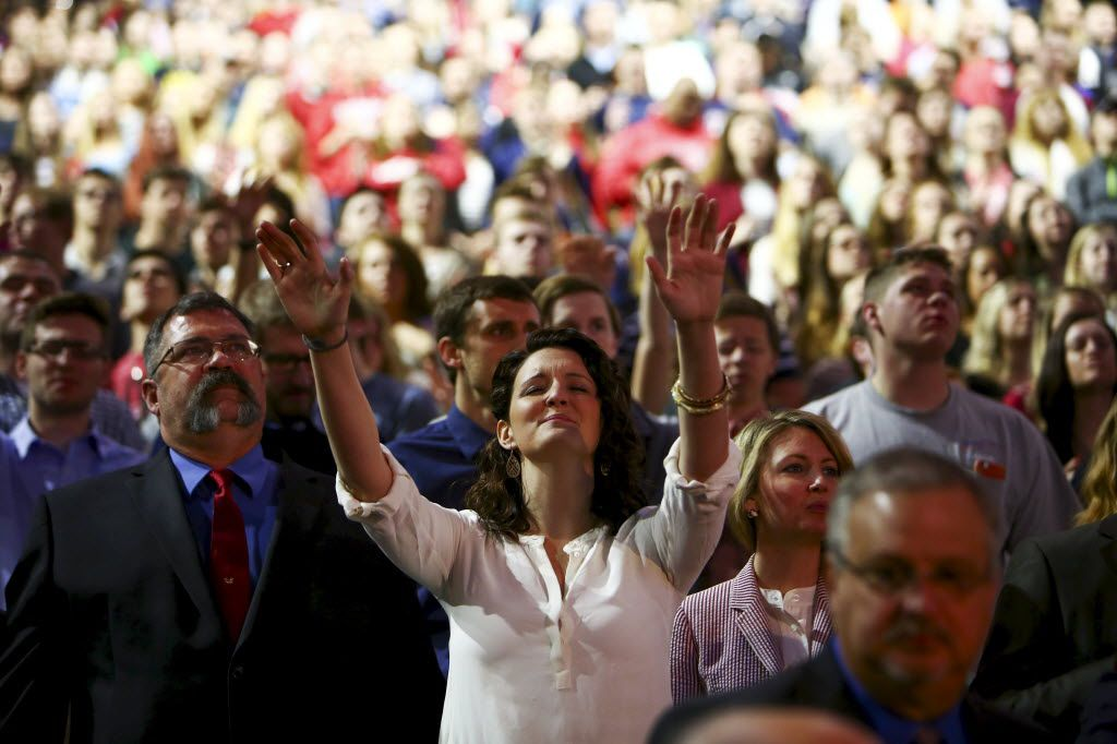 """An attendee raises her hands as religious music plays before Sen. Ted Cruz (R-Texas) spoke at Liberty University in Lynchburg, Va., March 23, 2015. Cruz on Monday formally announced his candidacy for the 2016 Republican presidential nomination, promising a campaign that would be about """"re-igniting the promise of America."""" (Travis Dove/The New York Times) 03242015xNEWS"""