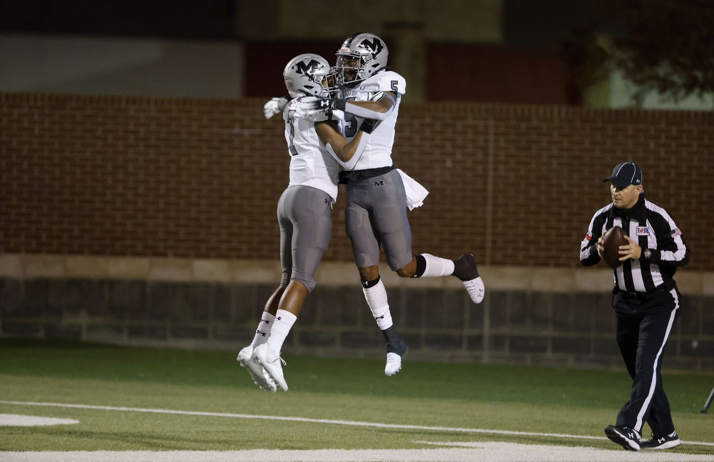 Arlington Martin's Lenard Lemons (5) celebrates his touchdown with Kryon Askey (7), right, against Lewisville during Class 6A Division I area-round playoff hight school football game on Dec. 17, 2020. (Michael Ainsworth/Special Contributor)