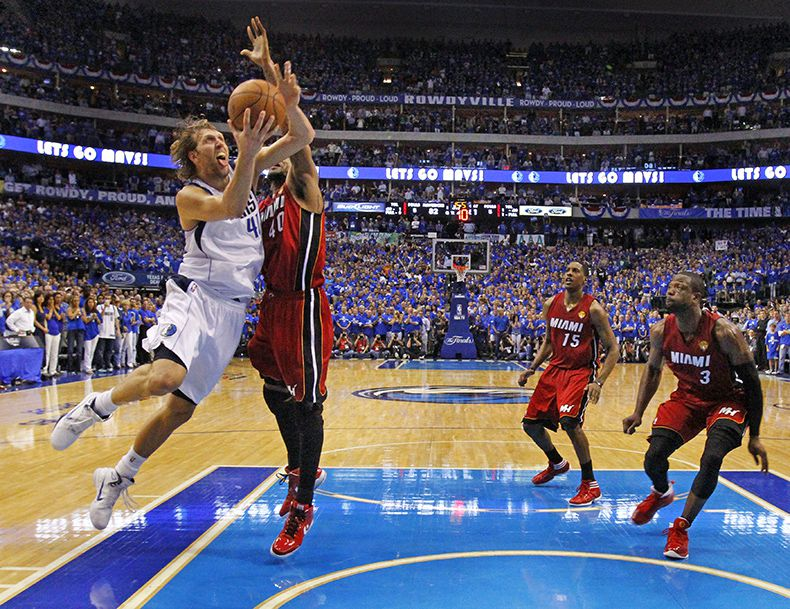 June 7, 2011--Dallas Mavericks Dirk Nowitzki (41) hits the big shot of the game to keep the Mavericks ahead of the Miami Heat late in the fourth quarter during Game 4 of the NBA Finals at American Airlines Center. The Mavericks won 86-83 to tie the series at 2-2. (Louis DeLuca/The Dallas Morning News)