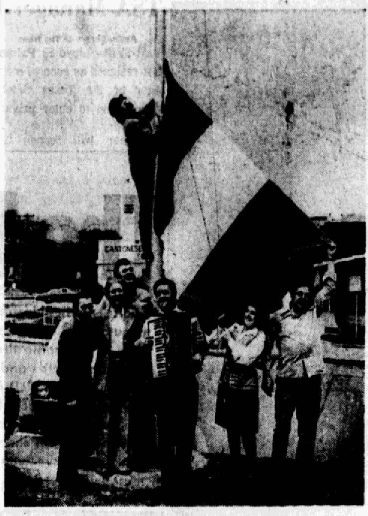 Image published in The Dallas Morning News on March 16, 1974. Original caption: When the flagpole's rope wouldn't work, Fred Kennedy took the Irish flag up by hand, assisted by (left to right) Joe Weisgerber, Mae Newman, Nick Farrelly, Sean Hall, Nancy Brent and Bernard Farrelly.