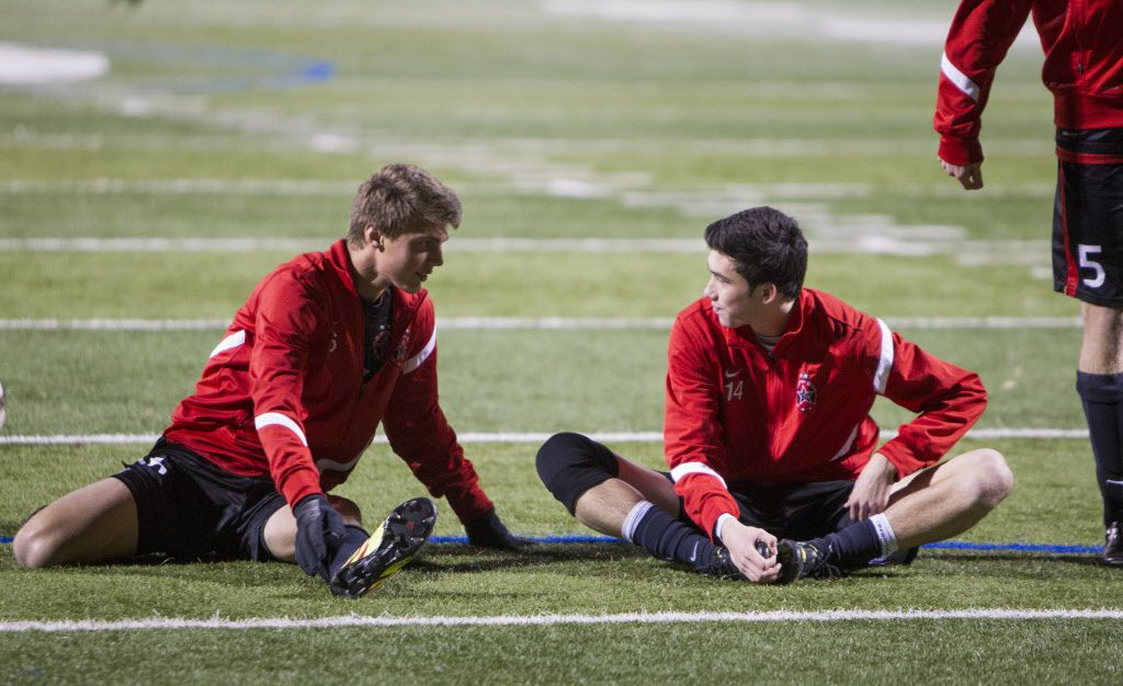 Kellen Reid (right), a senior at Coppell High School and a captain of the soccer team, talks with his teammate Justin Todd (left) as they stretch before their team's game against Lewisville on Tuesday, Feb. 25, 2014. Reid's mother, originally diagnosed with lung cancer, died March 2. (Matthew Busch/The Dallas Morning News)