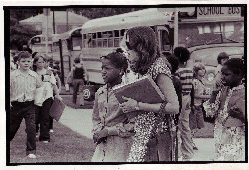 In a photograph from Aug. 29, 1977, when Bridgett Robinson, 9, needed direction to the right bus at Lakewood School, teacher Stephanie Zimmermann came to her aid.