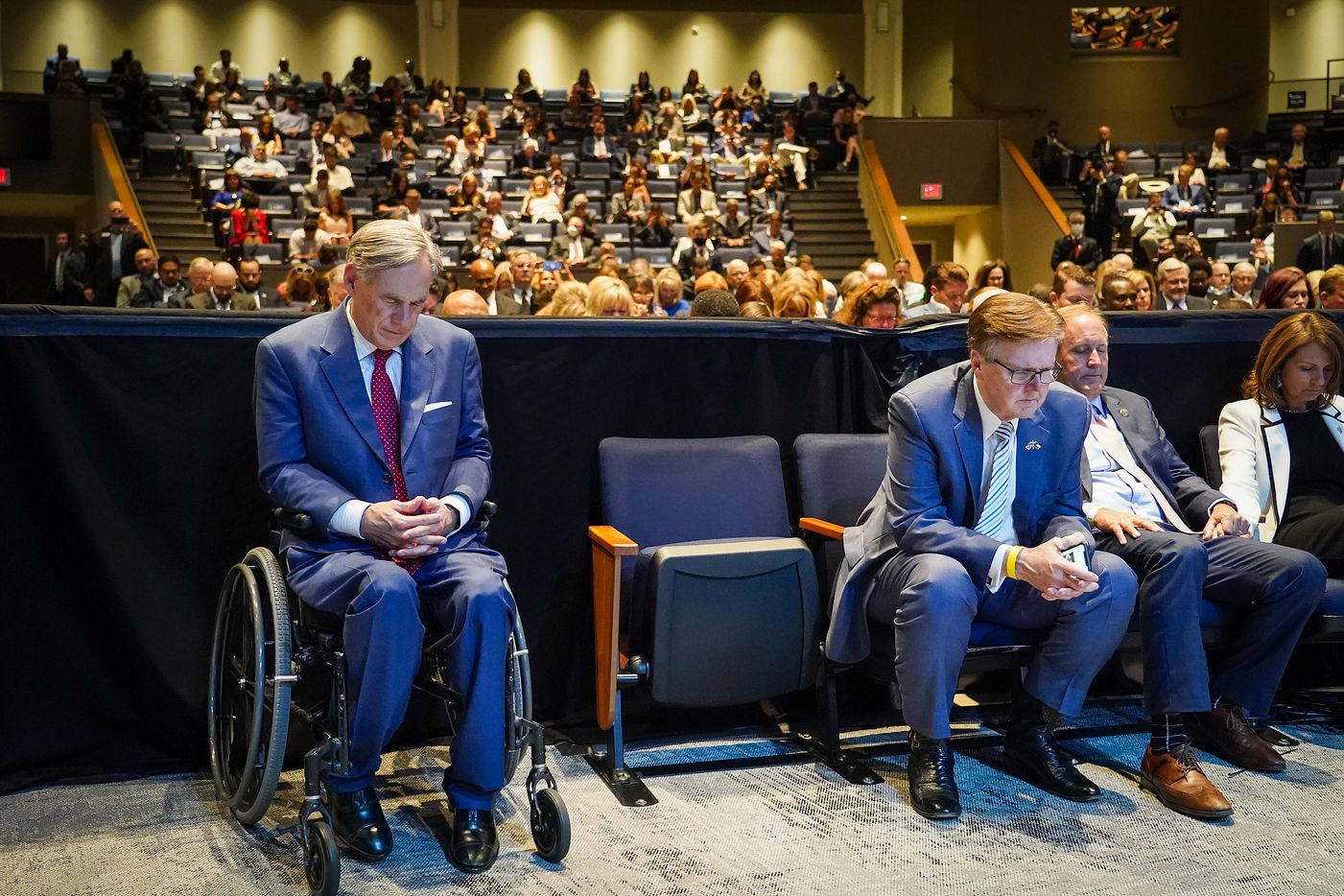 (from left) Texas Gov. Greg Abbott , Lt. Gov. Dan Patrick, and Attorney General Ken Paxton pray during a roundtable conversation about race relations and policing at Gateway Church Dallas Campus on Thursday, June 11, 2020, in Dallas. (Smiley N. Pool/The Dallas Morning News)