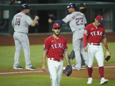 Texas Rangers pitcher Jonathan Hernandez and third baseman Derek Dietrich react after a single by Houston Astros first baseman Yuli Gurriel scored Jose Altuve to give the Astros a 3-2 lead during the eighth inning at Globe Life Field on Friday, Sept. 25, 2020.