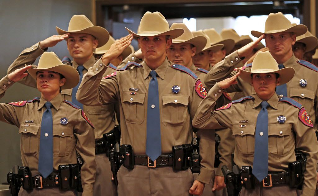 Members of the 155th trooper training class salute during the Texas Department of Public Safety recruit graduation ceremony at Shoreline Christian Center on Friday, June 17, 2016, in Austin, Texas.