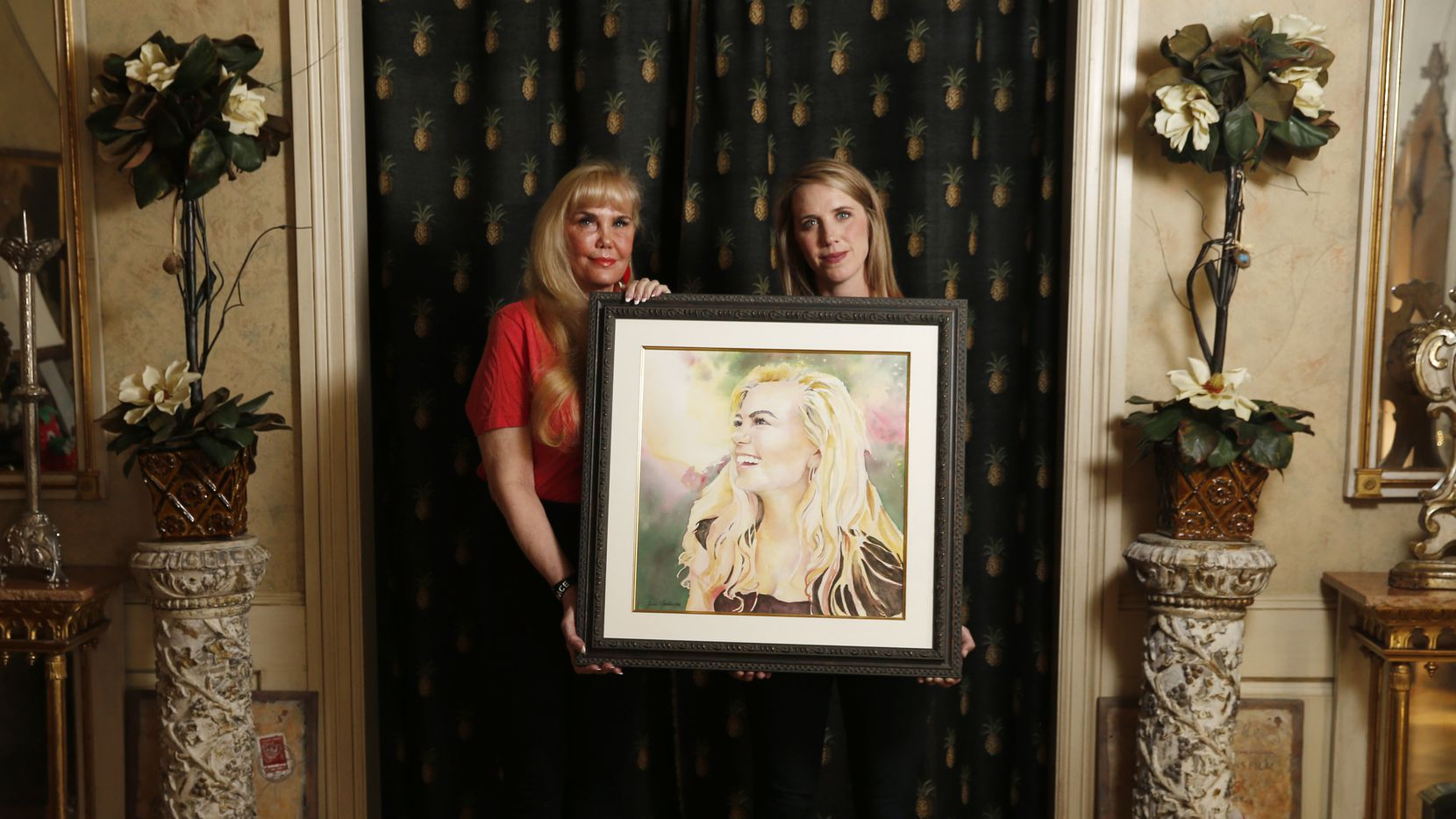 "Sue Loncar and daughter Sally Conway, who serves as executive director of the family's suicide-prevention nonprofit, hold a portrait of Grace Loncar, who died by suicide in 2016. ""Grace was loved and needed and her loss is so profound,"" her mother said this week."