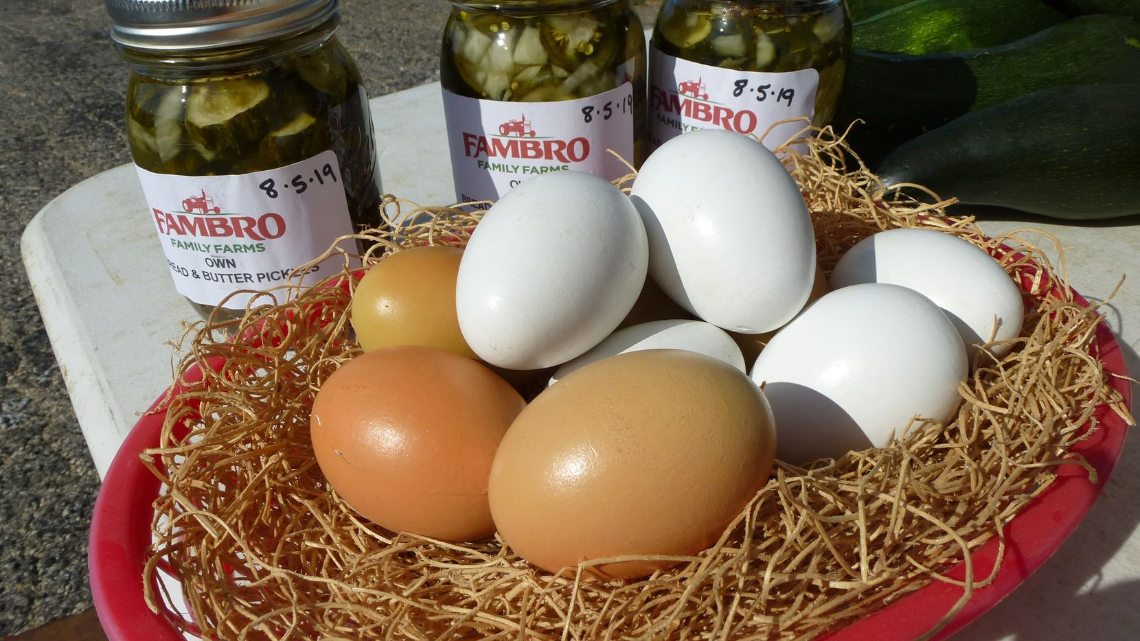 Fambro Family Farms from Breckenridge brings eggs, jarred pickles, eggplant, tomatoes and okra.