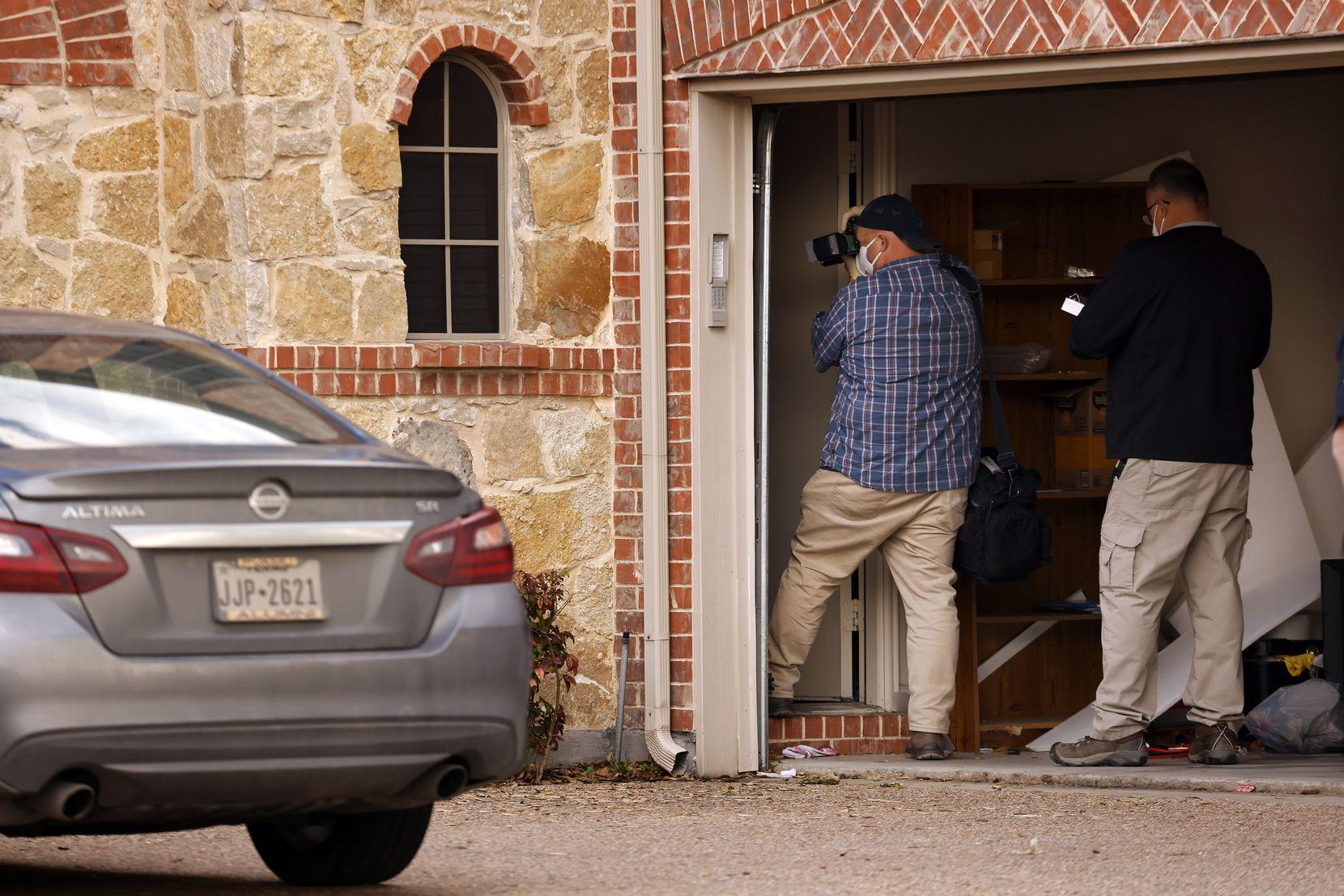 FBI agents took photos of the south Grand Prairie home Thursday evening.