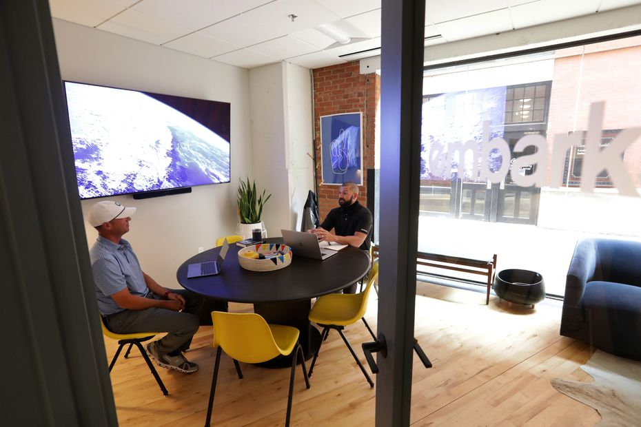 Clancy Fossum, left, and Paul Allen work in their office space at the West End area Common Desk in Dallas, TX, on Sep. 2, 2020. (Jason Janik/Special Contributor)