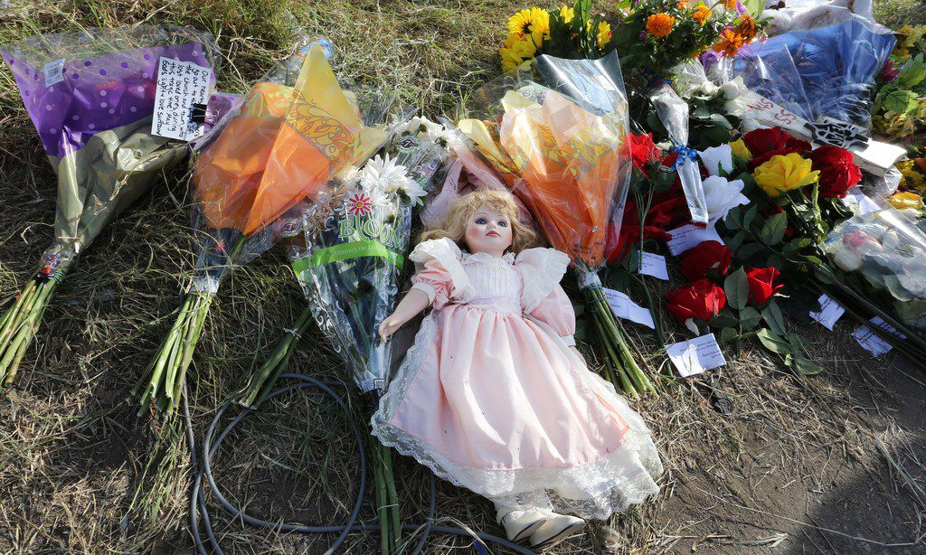 Remembrances left near the roadway on Highway 87 sit in the afternoon sun  in Sutherland Springs, Texas  as officials continue to investigate Sunday's shooting where 26 people died after a gunman opened fire at a Baptist church in the small town southeast of San Antonio. Photographed in Sutherland Springs, Texas on Tuesday, November 7, 2017. (Louis DeLuca/The Dallas Morning News)