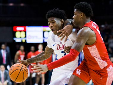 Southern Methodist Mustangs guard Kendric Davis (3) is defended by Houston Cougars guard Marcus Sasser (0) during overtime of a basketball game between SMU and University of Houston on Saturday, February 15, 2020 at Moody Coliseum in Dallas.