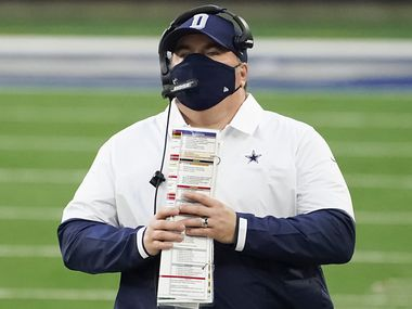 Dallas Cowboys head coach Mike McCarthy looks on from the sidelines during the second quarter of an NFL football game against the Philadelphia Eagles at AT&T Stadium on Sunday, Dec. 27, 2020, in Arlington.