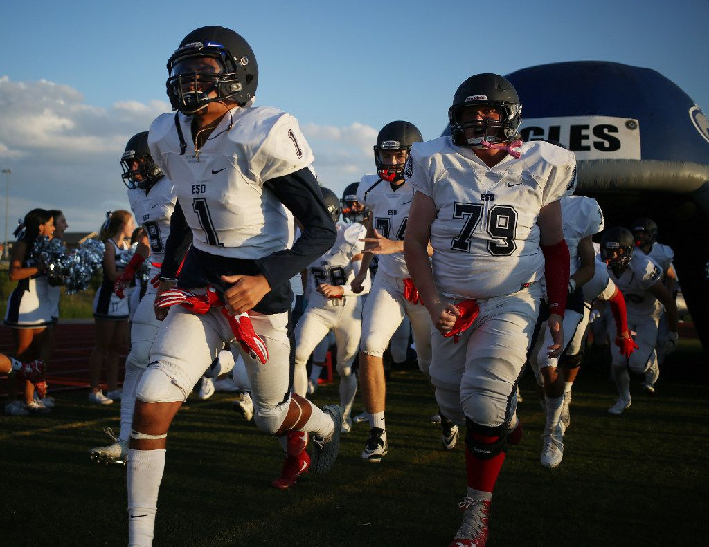 Episcopal School of Dallas players enter the field before a game in 2016. (Andy Jacobsohn/The Dallas Morning News)
