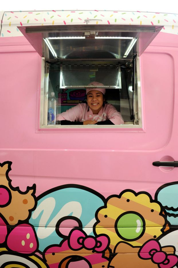 Krista Huynh helps fans place their order at the Hello Kitty Cafe Truck at The Shops at Willow Bend in Plano, TX on March 12, 2016. (Alexandra Olivia/ Special Contributor)